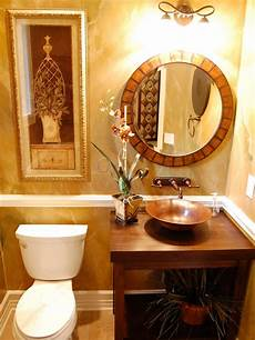 decor bathroom ideas traditional brown and gold guest bathroom with oval mirror hgtv