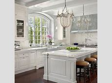 Modern French kitchen with white kitchen cabinets paired