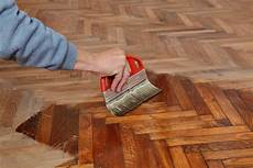 22815687 Varnishing Of Oak Parquet Floor Workers