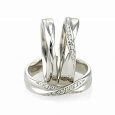 shaped crossover wedding rings in 18ct platinum and