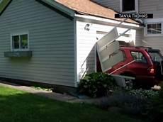 self garage 91 91 year fulfills list by crashing through a garage door