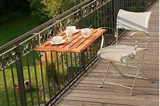 Balcony With A Folding Wooden Table Diy Balcony