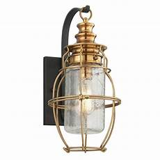 outdoor wall light with clear cage shade in aged brass forged black finish b3572