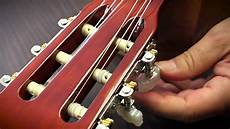 how to replace guitar strings how to change the strings on classical guitar