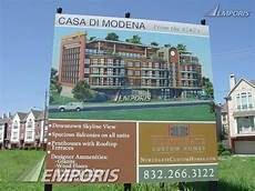 casa service modena sign with rendering at project site casa di modena
