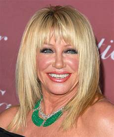 suzanne somers medium straight light blonde hairstyle with razor cut bangs