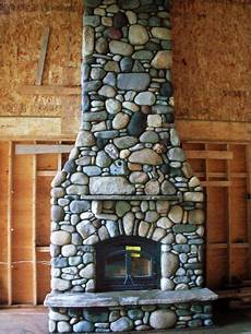 river rock fireplace interesting mixture of different sized rocks our house in