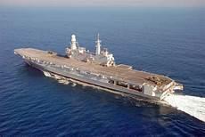 le portaerei italiane la portaerei cavour in africa per vendere le armi italiane