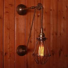pulley cage wall light apoch pulley cage wall light by mullan lighting