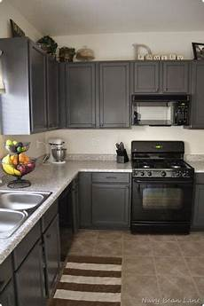black appliances and white or gray cabinets how to make it work grey kitchen cabinets grey