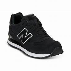 lyst new balance 574 sneakers in black for