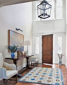 traditional white entry hall with high ceiling foyer