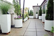 container arredati west side roof garden white planters terrace deck