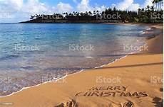 merry christmas written hawaii sand download image now istock