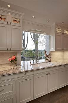 light kitchen with picture window and chic farmhouse