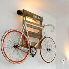 wall mounted bike holder made of wooden pallet indoor