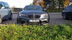 first shots of bmw m2 in mineral grey wearing terrible winter wheels
