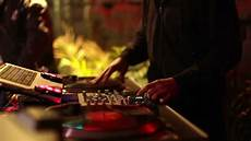 cool dj behind the turntables performing in a bar stock footage video 2321702