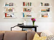 living room with nine white floating shelves hgtv
