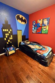 s batman superhero themed room with bat signal over the city wall mural batmobile bed and