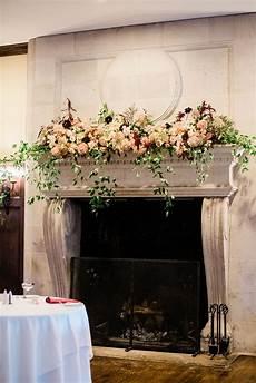 burgundy and blush fireplace mantel wedding fireplace decor wedding fireplace flowers photo