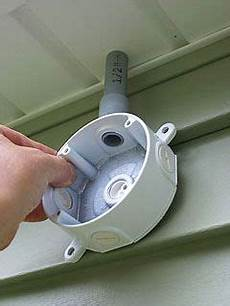 method of mounting outdoor junction box to outside wall just below roof overhang house stuff
