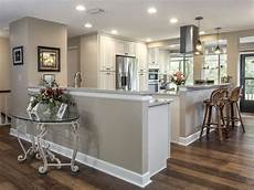 open kitchen in cream colored cabinets wood floors stainless steel appliances light tan brown