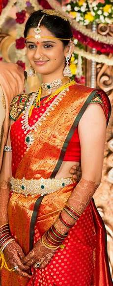 balu ralya kerala traditional hindu south indian bride temple jewelry jhumkis red silk