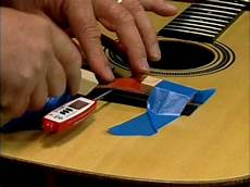 how to fix a guitar bridge repairing the lifted guitar bridge on dvd
