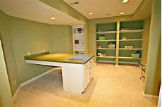 basement craft room fun and functional lower level craft room transitional