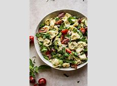 tortellini salad with fresh basil and tomatoes in vinaigrette_image