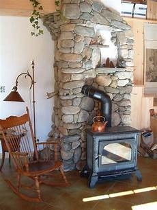 river stone stove surround rustic family room portland maine by natt king stoneworks river stone stove surround rustic family room portland maine by natt king stoneworks