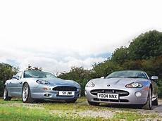 aston martin db7 jaguar xk8 clash of the classics jaguar xk8 v aston martin db7 ccfs uk
