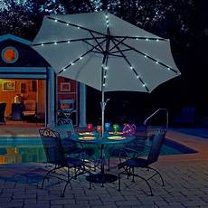 mirage 9 ft market solar led auto tilt patio umbrella in chagne olefin patio