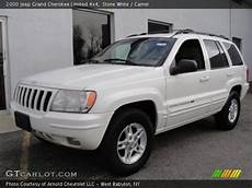 white 2000 jeep grand limited 4x4 camel