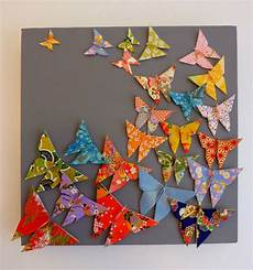 papillon papier decoration tableau envol de papillons multicolores en origami