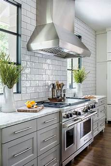 light gray kitchen cabinets with white and gray granite counters transitional kitchen