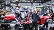 production tesla model 3 elon musk takes charge of tesla model 3 production roadshow
