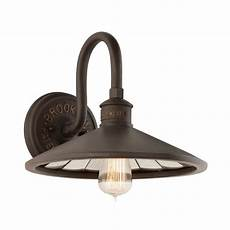 industrial wall sconce with vintage edison bulb in bronze