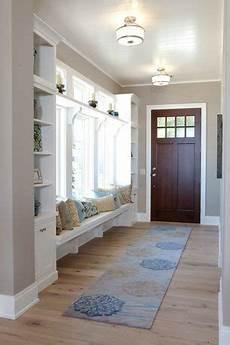 traditional entryway with hardwood floors window seat