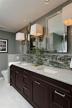 contemporary hotel style bathroom with glass tile backsplash hgtv