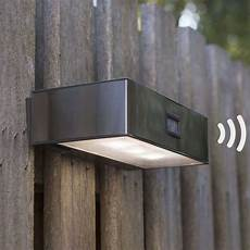 solar powered brick led sensor outdoor wall light lights co uk