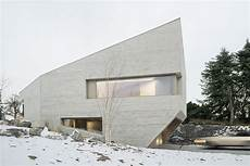 4 homes using concrete as a stylish angular concrete house in germany mimics a curbed