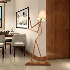 creative human figure floor ls wooden log fabric