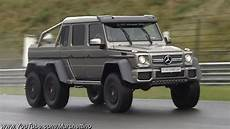 mercedes g63 amg 6x6 races supercars on track