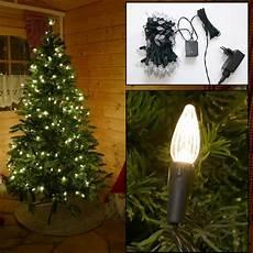 weihnachtsbaumlichterkette mit kerzen