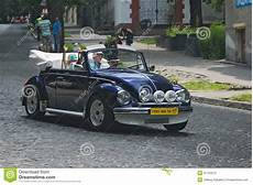 family driving volkswagen beetle at retrocar race editorial photography image of transport