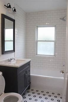 bathroom flooring ideas for small bathrooms farmhouse style bathroom remodel white subway tile shower gray vanity black and white