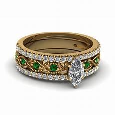 marquise cut milgrain diamond trio bridal sets with green emerald in 14k yellow gold