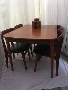 vintage dining table and 4 chairs extendable to seat 6